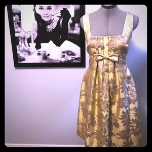 A silky, golden yellow dress with flower print